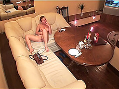 Girl on huge sofa voyeured playing hotly