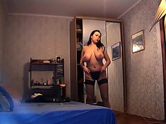 Big tits amateur posing in black lingerie