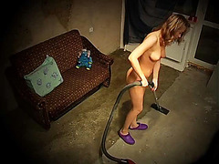 Cute girl with vacuum cleaner is naked