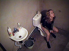 Girl getting relaxation on the toilet cam
