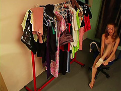 Half naked doll on fitting room spy cam
