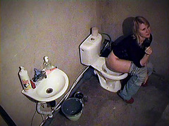 Blonde smoking in toilet with spy cam