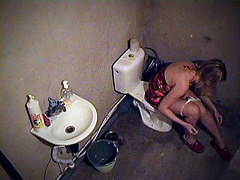 Girl smoking on toilet in voyeur movie