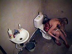 Girl smoking on toilet in voyeur movie