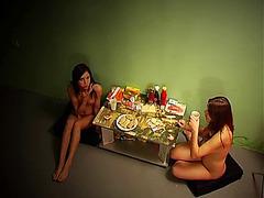 Naked amateurs having dinner on the floor