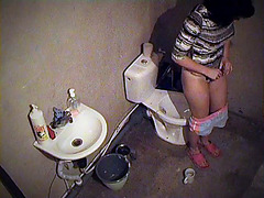 Toilet spy cam is shooting babe pissing